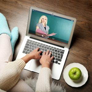 Woman video conferencing with tutor on laptop at home. Distance
